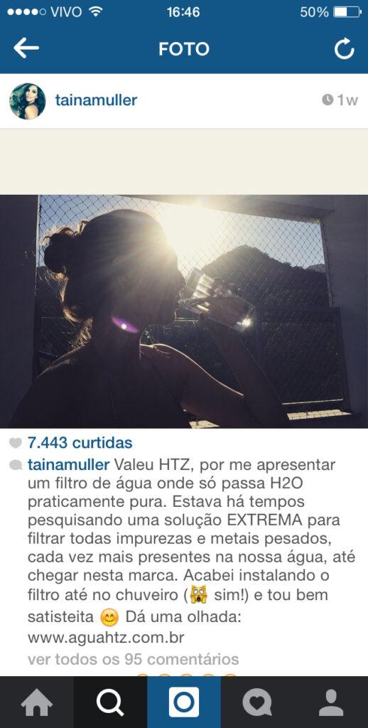 Taina Muller bebendo água de filtro HTZ